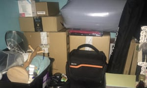 pile of things including boxes, bags, and saucepans