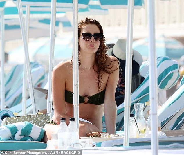 Snack: Anna was seen enjoying a sandwich on the beach following her swim