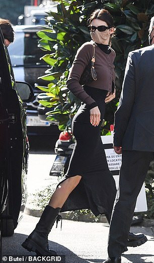 Boots made for walking: Kendall boosted her height in a pair of thigh-high lace-up boots