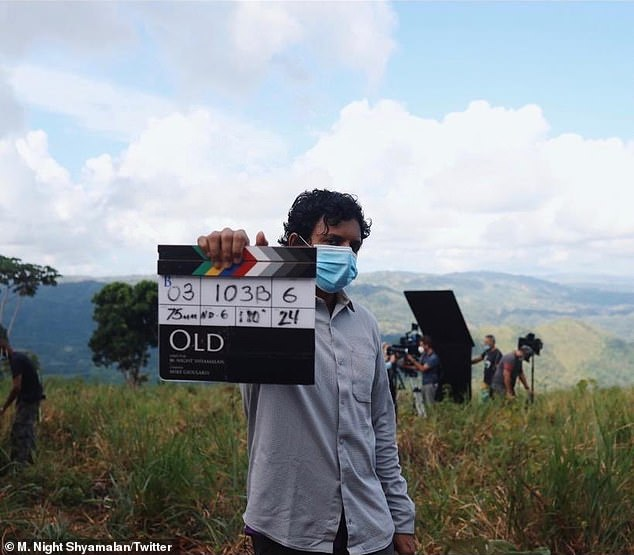 New project: Shyamalan shared a photo from the set for the first day of filming.'Feels like a miracle that I am standing here shooting the first shot of my new film. It's called Old,' he wrote