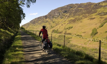 Cyclist on Sustrans cycling route 7, a former railway line, at Glen Ogle, Scotland