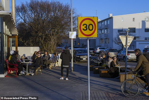 People sit outdoors at a restaurant in Reykjavik on April 29, when most of Europe was in the depths of lockdown but Iceland was able to avoid one with effective testing and tracing