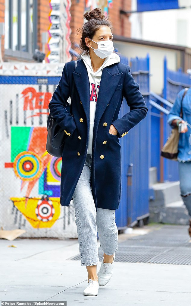 Effortlessly chic: The 41-year-old actress, who has been nearly inseparable with her new boyfriend Emilio Vitolo Jr., cut a casual figure in a white hoodie and a pair of light-wash jeans on Wednesday