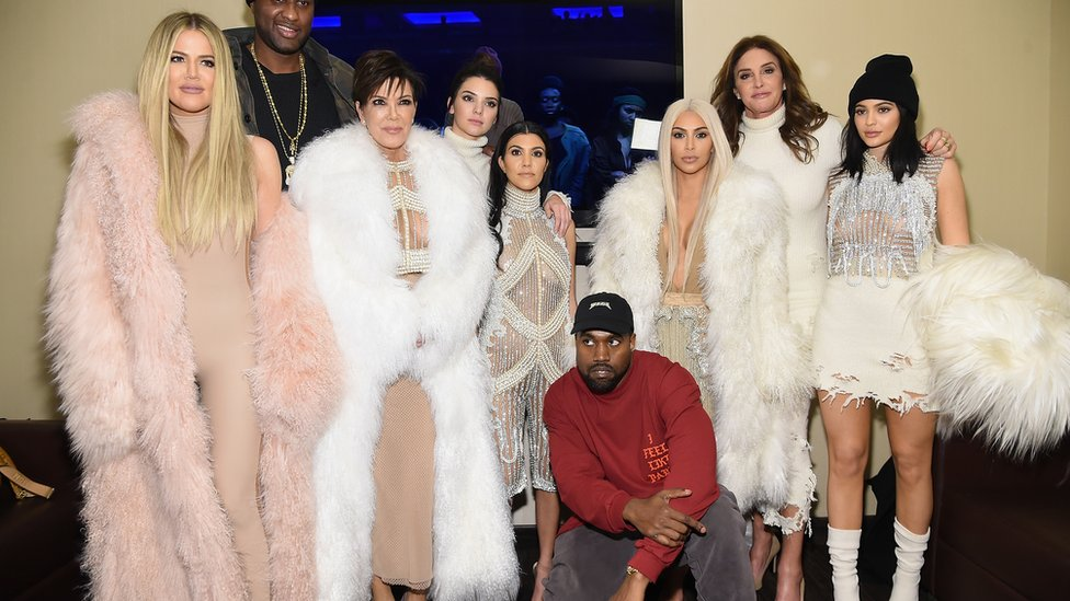 From left to right: Khloe, Lamar Odom, Kris Jenner, Kendall, Kourtney, Kanye, Kim, Caitlin and Kylie and Kanye West