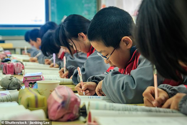 The 45-year-old father, known by his surname Liu, sought medical attention after he began suffering chest pain and suddenly passed out while explaining a maths question to his Year 3 son. The file photo shows students working in a classroom at Huaiyang Middle School