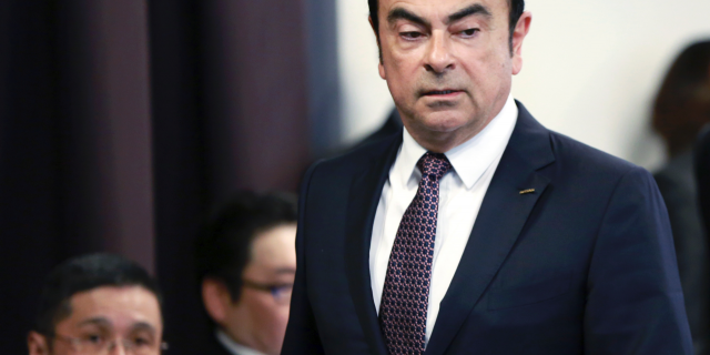 FILE - In this May 12, 2016, file photo, then Nissan Motor Co. President and CEO Carlos Ghosn arrives for a joint press conference with Mitsubishi Motors Corp. in Yokohama, near Tokyo. (AP Photo/Eugene Hoshiko, File)