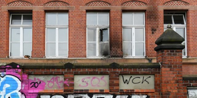 A broken window is pictured at the Robert Koch Institute (RKI) for infectious disease in General-Pape-Strasse, as the coronavirus disease (COVID-19) outbreak continues, in Berlin, Germany, October 25, 2020. (Reuters/Annegret Hilse)