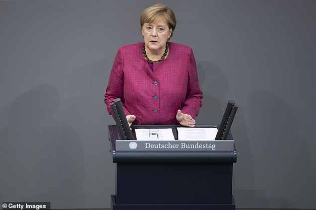 German Chancellor Angela Merkel today defended a new wave of restrictions aimed to manage the second wave of the virus, including the closure of bars and restaurants and limits on social contacts (pictured)