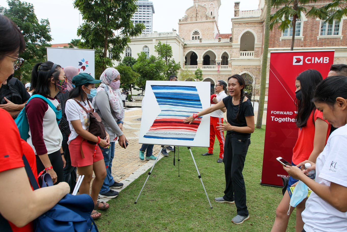 Luanne Sieh, CIMB's head of sustainability, explaining the 'warming stripe' history of global warming.