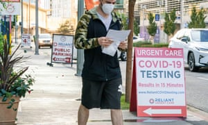 A man exits a Covid-19 testing center amid the coronavirus pandemic in Los Angeles.