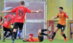Roberto Insigne (centre) celebrates opening the scoring for Benevento.