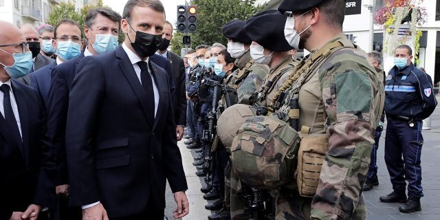 French President Emmanuel Macron, center, meets soldiers after a knife attack at Notre Dame church in Nice, southern France, Thursday, Oct. 29, 2020. (Eric Gaillard/Pool via AP)