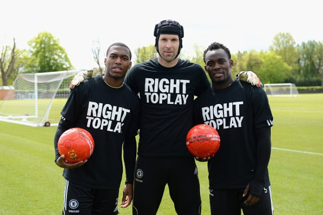 Daniel Sturridge, Petr Cech, Michael Essien of Chelsea with Right To Play ball after a training session at the Cobham training ground on May 15, 2012 in Cobham, England.