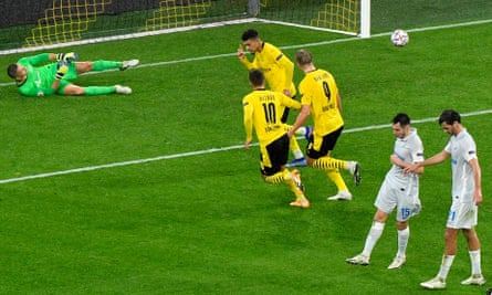 Jadon Sancho celebrates after scoring from the penalty spot.