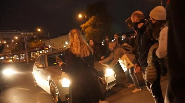 A spy working for Poland's equivalent of MI5 ploughed his car into a group of women protesting against the country's new abortion laws