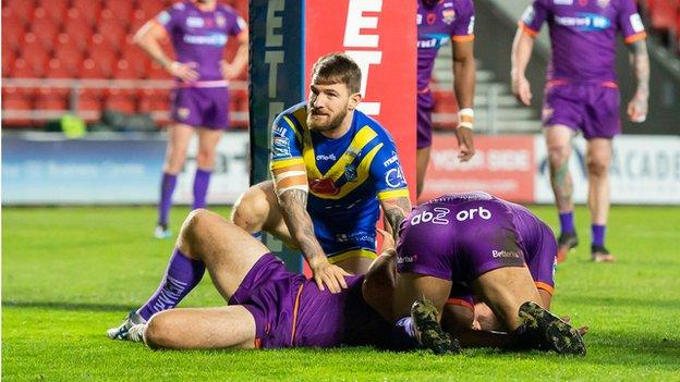 Warrington's Daryl Clark scores his first try against Huddersfield
