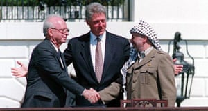 Yitzhak Rabin and Palestinian leader Yasser Arafat with President Clinton, sealing the Oslo accords with a handshake, in September 1993 on the White House lawn