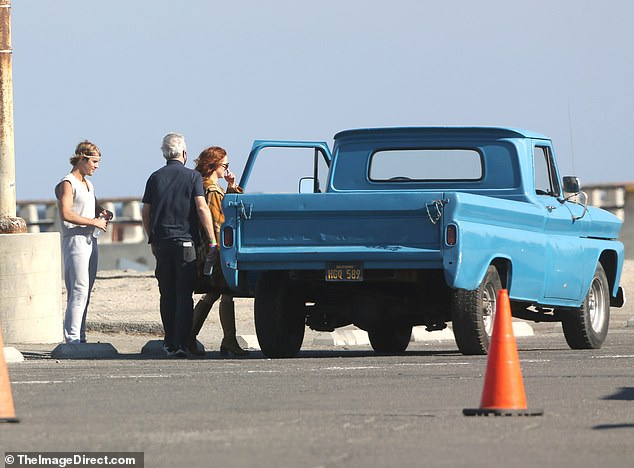 Truck:The co-star was also spotted walking up to and getting into a vintage blue Chevrolet truck during the shoot