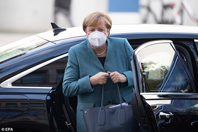 Angela Merkel, pictured arriving for a party meeting in Berlin today, is set to discuss lockdown plans with the leaders of Germany's 16 states on Wednesday