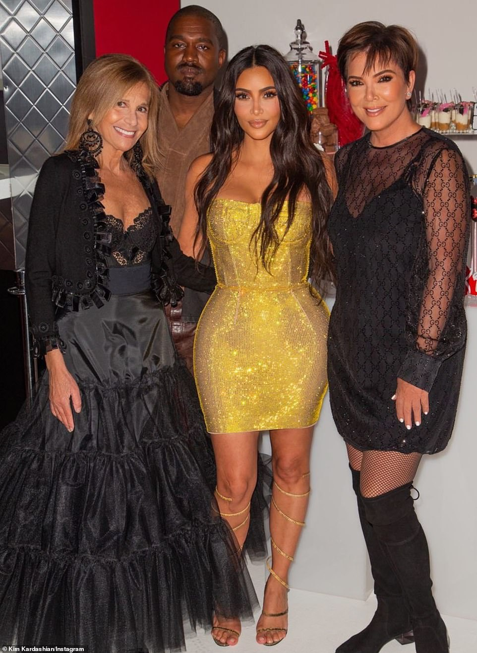 Her loves ones: Also seen were her husband Kanye West, mom Kris Jenner, andthe first cousin of her late father Robert Kardashian, Cici (far left)