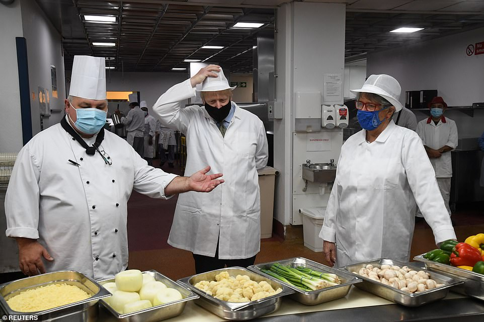 Prime Minister Boris Johnson reviews hospital food at the Royal Berkshire Hospital in Reading, October 26