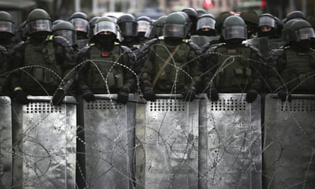 Belarusian police block a street during an opposition rally on 25 October