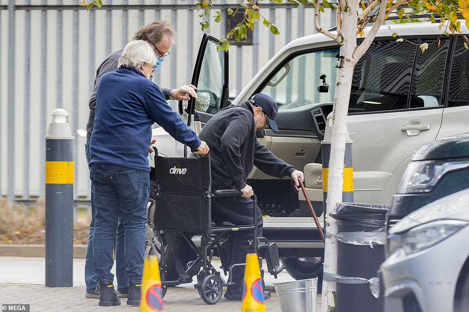 A helping hand:The legendary hitmaker, 69, emerged from a car while using a stick for assistance before his peer, 70, helped navigate him into a wheelchair on Tuesday, in a sighting that comes after the iconic hitmaker underwent multiple back surgeries, which have left him struggling to stand
