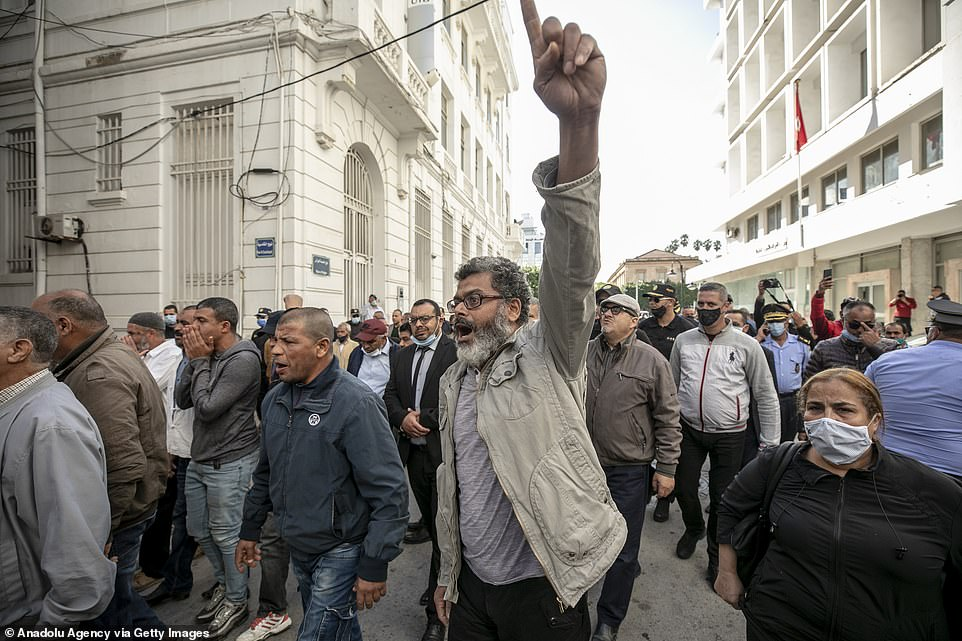 Thousands of protesters marched through the streets of Tunisia on Thursday, as anger at the publication of cartoon of Mohammed spread across the Muslim world