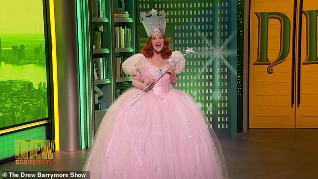 Fun!Drew Barrymore was Glinda The Good Witch from The Wizard Of Oz on her talk show. The Charlie's Angels star looked stunning in the pink gown with a silver hat and wand