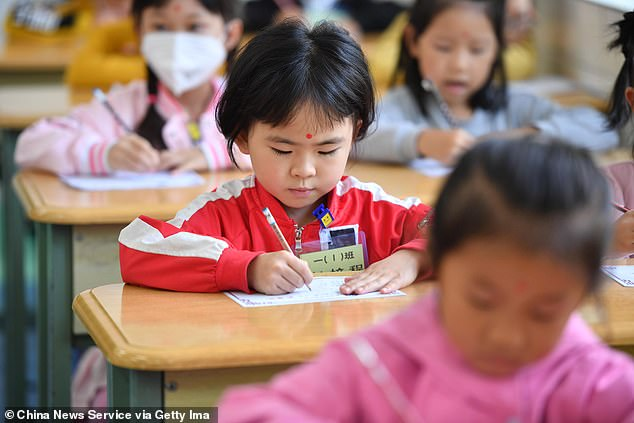 A Chinese man has nearly died from severe heart attacks after he got extremely upset while helping his son with homework. In this file photo, pupils sit at a class at a primary school on the first day of a new semester on September 1, 2020 in Kunming, Yunnan province