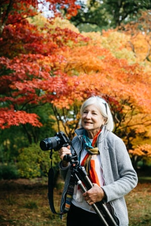 Ginny Campbell, a visitor from Devon photographing the trees at Westonbirt for a camera club competition.