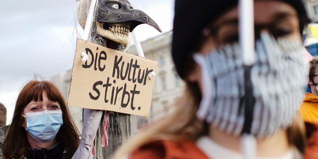 A woman holds a poster reading:'The culture dies' as she attends a protest of people working in the entertainment and event industry against the German government's economic policies to combat the spread of the coronavirus and COVID-19 disease and demand more support for their business, in Berlin, Germany, on Wednesday. (Photo/Markus Schreiber)