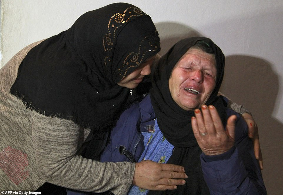 KILLER'S MOTHER: Kmar (right), the mother of Nice attacker Brahim Aouissaoui who killed three people in Thursday's terror attack, cries at her home in Tunisia last night after being questioned by counter-terrorism police