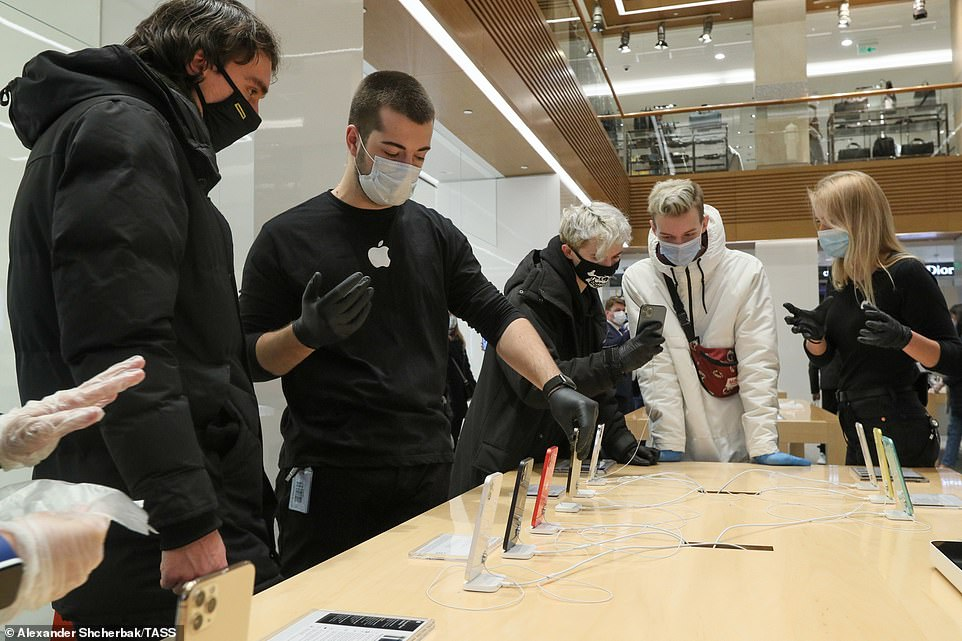 People visit a re:Store shop in Moscow's Petrovka Street, as Apple has launched iPhone 12 and iPhone 12 Pro sales in Russia