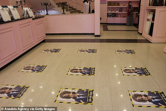 The Macron portraits were defaced with footprints as the French president is targeted by protests for defending blasphemous cartoons of the Prophet Mohammed