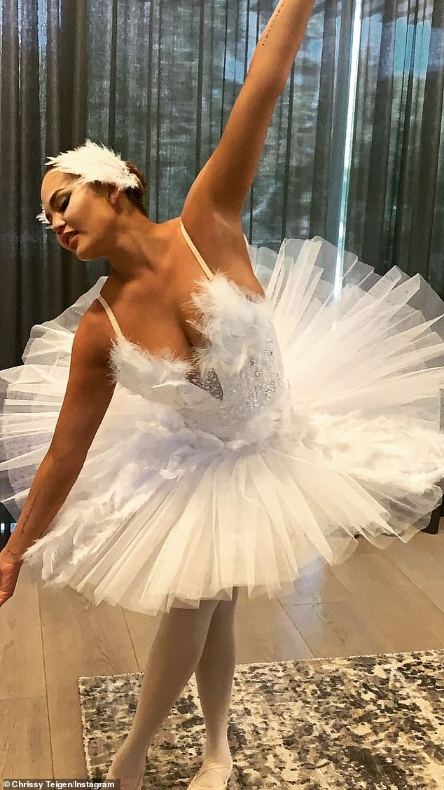Graceful:Chrissy Teigen, who recently suffered the heartbreak of baby loss, put on a happy face while dressing up as the lead from the ballet Swan Lake