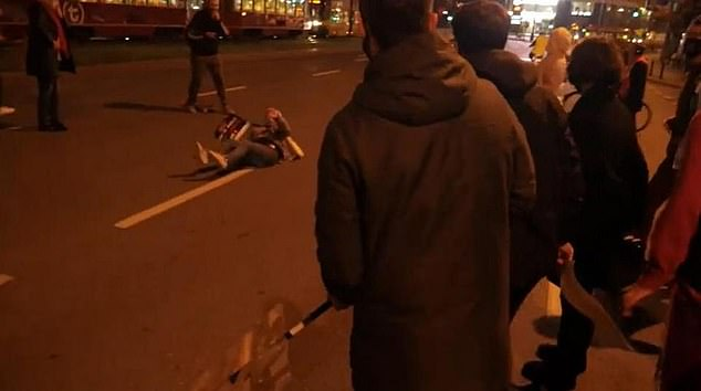 The 44-year-old man was captured on mobile phone camera ramming his BMW into the protesters as they tired to block traffic in the Polish capital Warsaw
