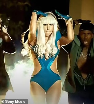 Hasn't changed a bit! Gaga even stepped back into her teal cutout body suit and blonde bangs from the Poker Face video