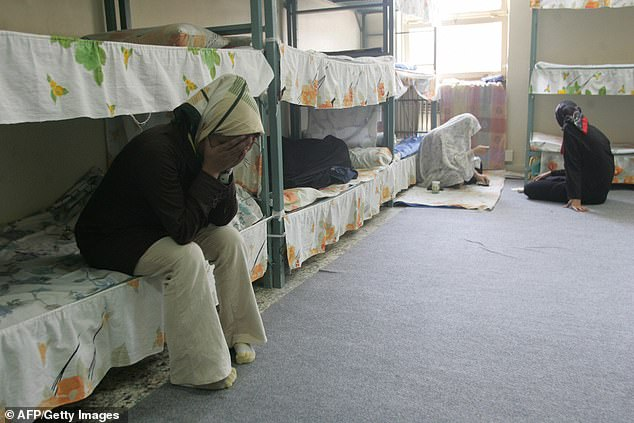 Iranian women inmates sit at their cell in the infamous Evin jail, north of Tehran, in 2006