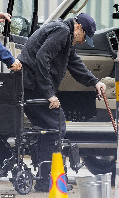 Assistance: He was helped into a wheelchair after arriving at the studio