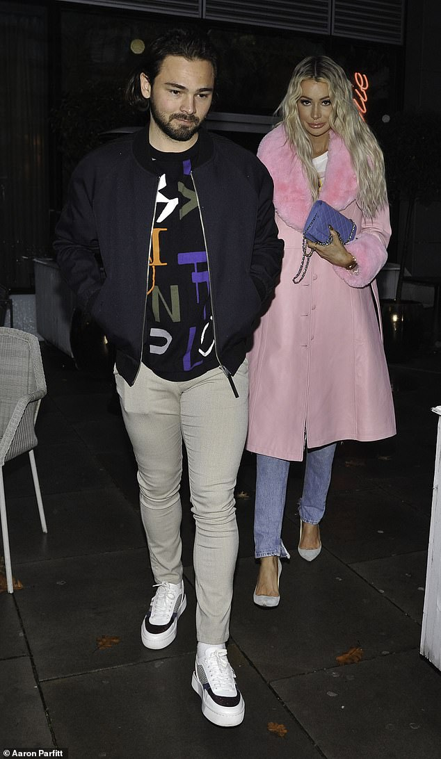 Looking good:The Love Island star, 29, turned heads in a stylish baby pink coat as the couple continued to film scenes for their reality show Olivia Meets Her Match