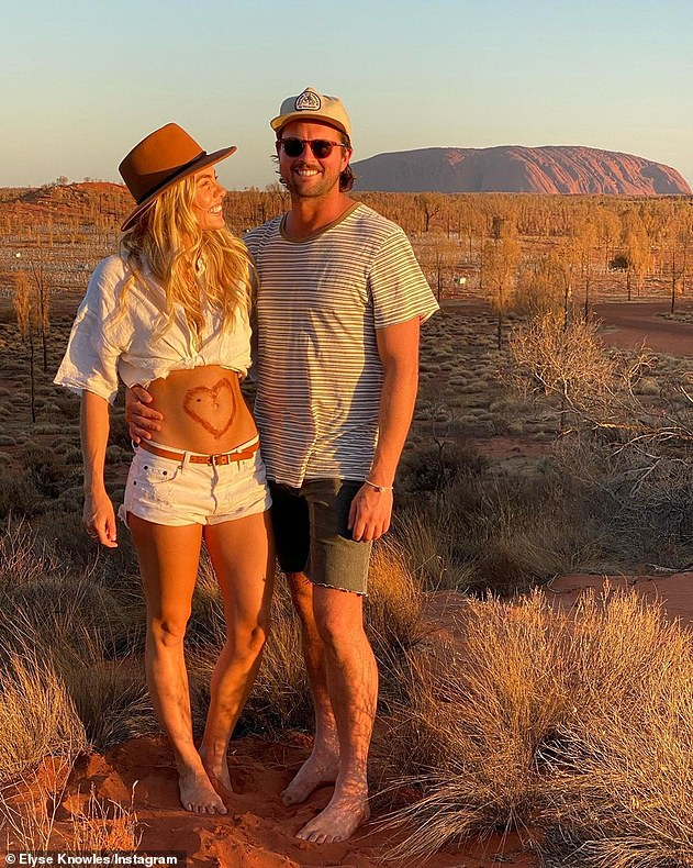 'Then there were three': Elyse and her boyfriend Josh (both pictured) announced their pregnancy news while holidaying in the Northern Territory