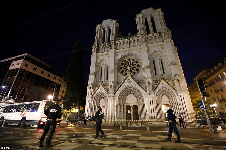 French police officers secure the street near the entrance of the Notre Dame Basilica church in Nice