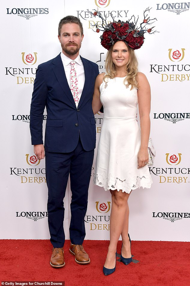 His spouse: Amell with wife of eight years Cassandra Jean at the 145th Kentucky Derby at Churchill Downs in Louisville, Kentucky in May 2019