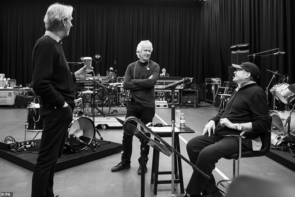 Icons:The music legend smiled as he rehearsed with Tony Banks (centre) and Mike (left) on Monday