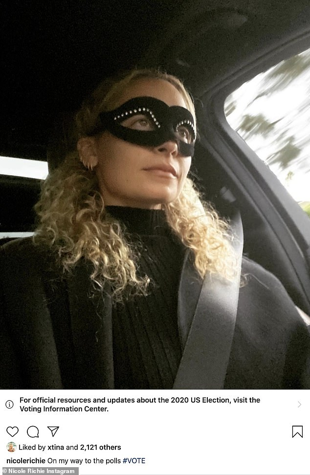 The Simple Voter: Nicole Richie had on a black eye mask with rhinestones and a black top as she was seen in a car with her seat belt on. The mother of two who is married to Joel Madden wore hair was down and curly as she looked ahead
