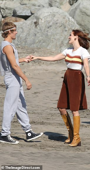 Beach walk: The singer was also spotted walking along with beach with the co-star for the video shoot, though it is unclear what song the video is for