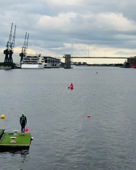 Victoria Pointon's son Ted preparing to swim at Canning Town Docks, in London