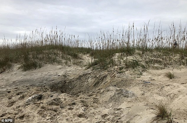 The crater left by the detonation. Other unexploded ordnances washed ashore nearby in 2017, including one at the edge of Hatteras Inlet and another on a temporary sandbar off Cape Point