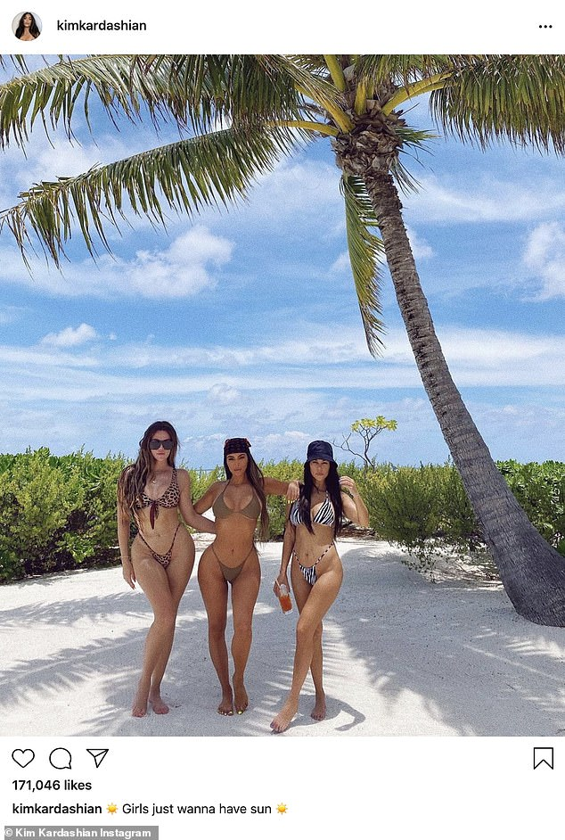 Fine now: Khloe was also seen on Wednesday in a new image from Kim's 40th birthday bash in a tropical setting with white beaches. She posed with Kim and Kourtney on the shore. Kim has been heavily criticized for taking a lavish vacation amid COVID-19 when so many people are dying from the virus and suffering from losing their jobs